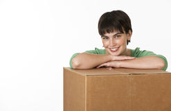 Beautiful Brunette Leaning on Box Royalty Free Stock Photos