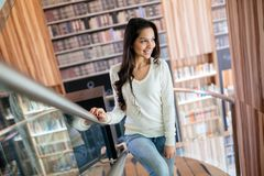 Beautiful brunette in library royalty free stock images