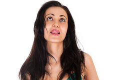 Beautiful brunette licking her lips Stock Images