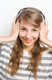 Beautiful brunette lin headphones, big smile. Stock Image
