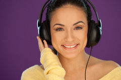 Beautiful brunette listening to music Royalty Free Stock Image