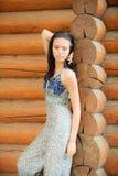 Beautiful brunette at log hut Royalty Free Stock Photos