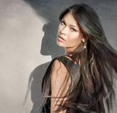Beautiful brunette with long hair in motion Stock Image
