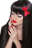Beautiful brunette with long hair  and professional makeup, mani. Cured polish nails Stock Photos