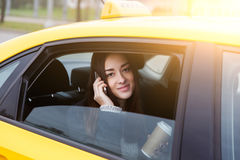 Beautiful brunette with long hair talking on phone sitting Royalty Free Stock Photo