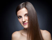 Beautiful brunette with long straight hair Royalty Free Stock Photo