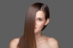 Beautiful brunette with long straight hair. Beautiful young brunette with long straight hair Royalty Free Stock Images
