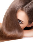 Beautiful brunette with long straight and shiny hair Stock Images