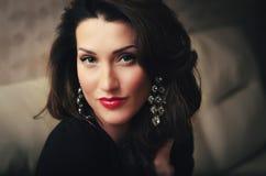 Beautiful brunette with long wild hair portrait. Studio shot Stock Photography