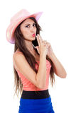 Beautiful brunette longhaired woman with pink cowboy hat. Stock Image