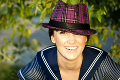 Beautiful brunette looking at you. Beautiful brunette in hat looking at you Stock Photo
