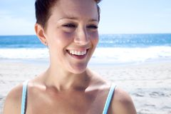 Beautiful Brunette looks at the beach Stock Photos