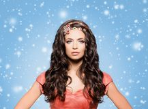 Beautiful brunette with luxury golden necklace over blue winter Royalty Free Stock Images