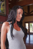 Beautiful brunette in luxury home Stock Image