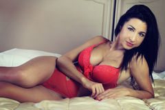 Beautiful  brunette lying on a bed Stock Photo
