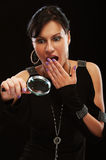 Beautiful brunette with magnifying glass Stock Image