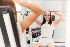 Beautiful brunette make exercise Royalty Free Stock Images
