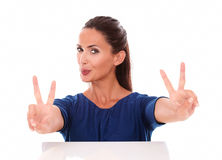 Beautiful brunette making two victory sign Stock Images