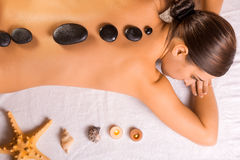 Beautiful brunette in a massage parlor Royalty Free Stock Photography