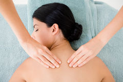 Beautiful brunette on massage table Royalty Free Stock Images