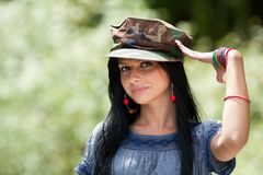 Beautiful brunette with military cap saluting Royalty Free Stock Photo