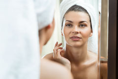 Beautiful brunette in the mirror Royalty Free Stock Photos