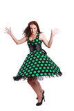 Beautiful brunette model. Poses in polka-dot dress royalty free stock photography