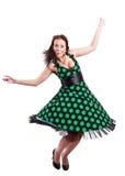 Beautiful brunette model. Poses in polka-dot dress stock photography