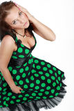 Beautiful brunette model. Poses in polka-dot dress royalty free stock image