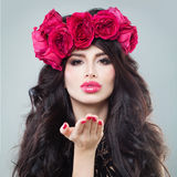 Beautiful Brunette Model Blowing a Kiss Royalty Free Stock Images