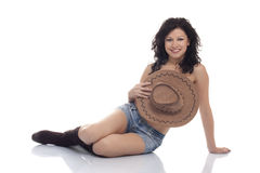 Beautiful brunette model with a cowboy hat. Over white background royalty free stock images