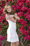 Beautiful Brunette Model in front of Flowers Royalty Free Stock Photography