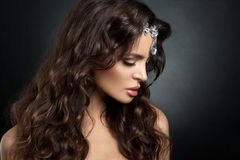 Beautiful brunette model with long curly brown Royalty Free Stock Photo