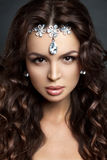 Beautiful brunette model with long curly brown Royalty Free Stock Photography
