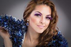 Beautiful brunette model portrait, purple make-up Stock Photos