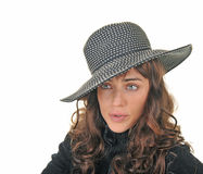 Beautiful brunette model wearing a hat. Beautiful brunette model with pursed lips on white background with room for text Stock Photo