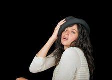 Beautiful brunette model wearing a hat. Beautiful woman wearing a hat on a black background Stock Photos