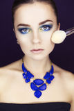 Beautiful brunette model woman in blue necklace and with evening Royalty Free Stock Photography