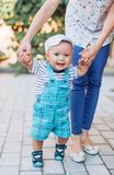 Beautiful brunette mother with baby boy. Smiling for a magazine in the studio royalty free stock photography