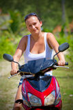 Beautiful brunette on the motor bike Royalty Free Stock Photography