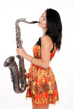 Beautiful brunette with a musical instrument Royalty Free Stock Photography