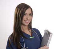 Beautiful Brunette Nurse Holds Patient Medical Chart Data in Cli Stock Images
