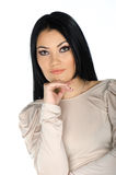 Beautiful brunette with one hand to her chin Royalty Free Stock Image
