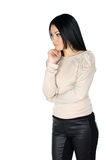 Beautiful brunette with one hand to her chin Stock Photography