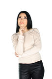 Beautiful brunette with one hand to her chin Royalty Free Stock Photo