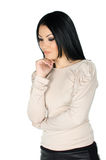 Beautiful brunette with one hand to her chin Royalty Free Stock Photography