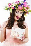 Beautiful brunette opens a gift box Royalty Free Stock Images