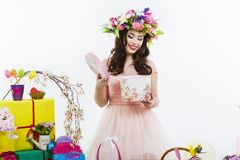 Beautiful brunette opens a gift box Stock Photo