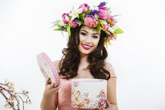 Beautiful brunette opens a gift box Stock Photos