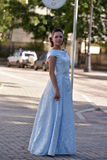 Beautiful brunette in pale blue evening dress Royalty Free Stock Photography